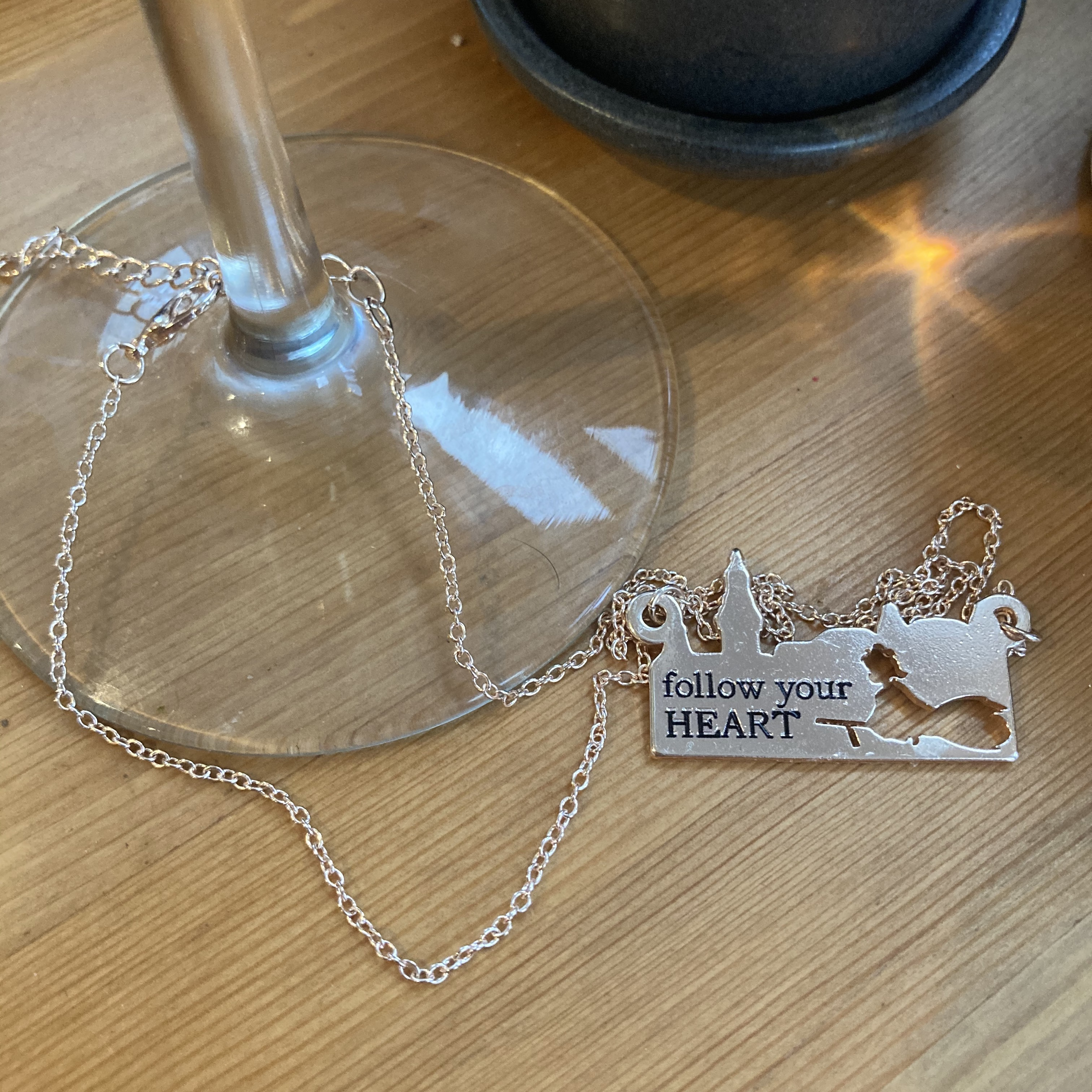 "Necklace with ""Follow your heart"" imprinted"